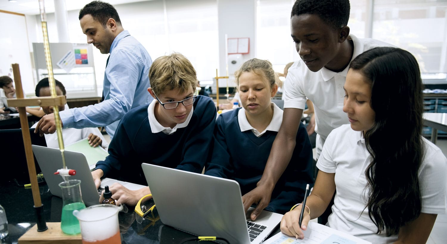 students work together science class laptop