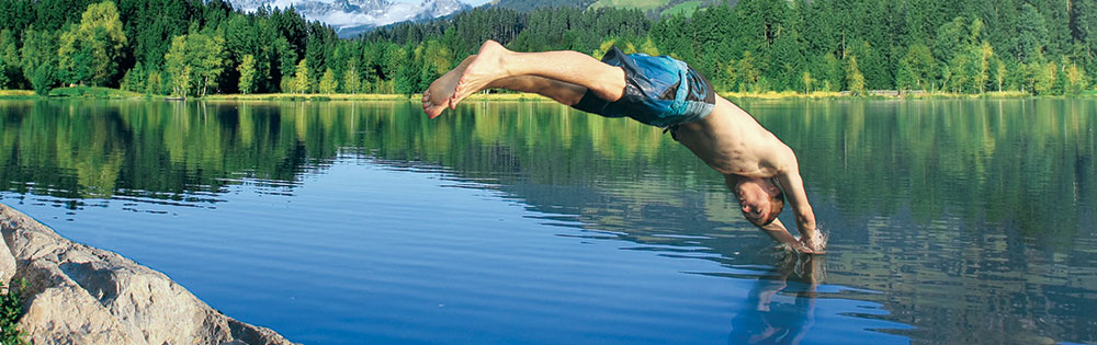 guy diving into a lake