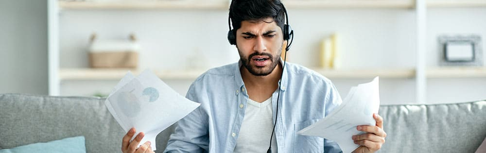man work from home headset confused