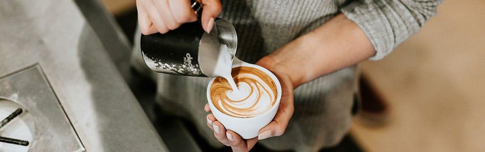 barista making coffee close up