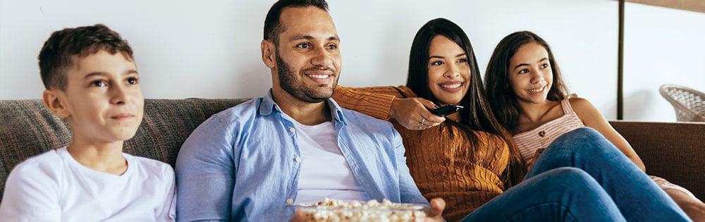 family watching movie popcorn
